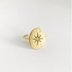 Ring met zon en lichtblauwe steen
