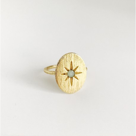 Ring with sun and light blue stone